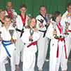 taekwondo students from burntwood and cannock taekwondo pose with the awards they won at the lincolnshire open