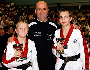 burntwood and cannock taekwondo instructor sean hardwick with winners of the taekwondo tigers tournament