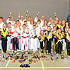 burntwood and cannock taekwondo students with the many awards they have won at local and national taekwondo tournaments